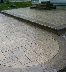 Tuscany stone stamped concrete patio